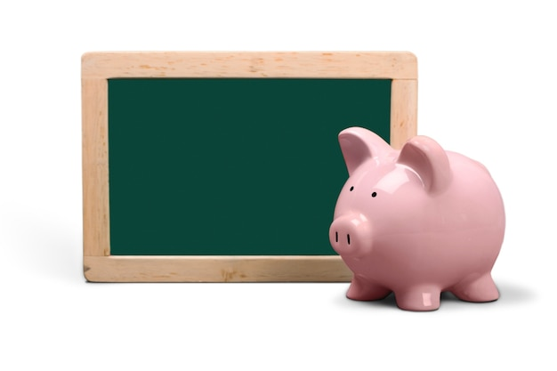 Pink piggy bank and chalkboard