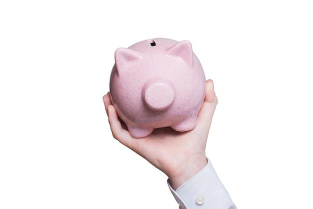 어린이 손에 핑크 돼지 저금통입니다. 확대. 사업 개념. 분리