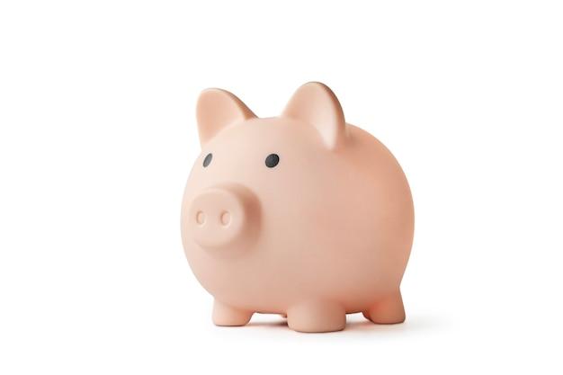 白で隔離のピンクの貯金箱。お金を保存し、節約するという概念。