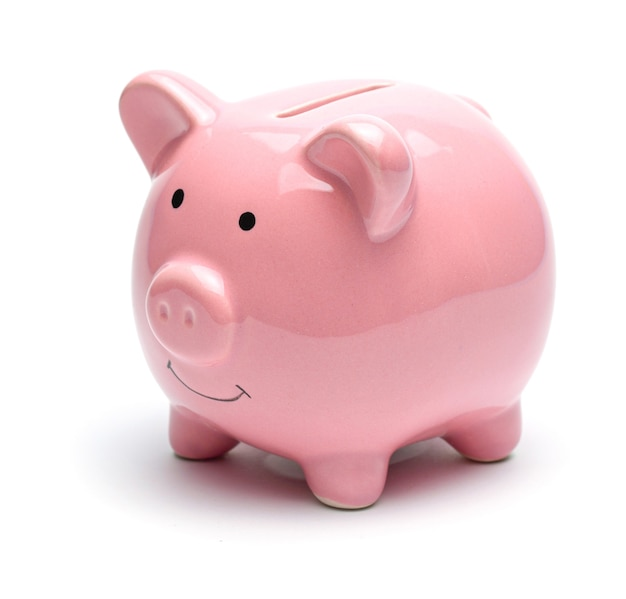 Pink piggy bank isolated on a white background.