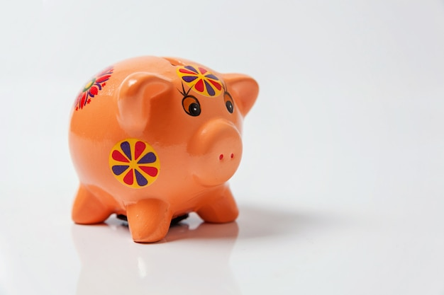 Pink piggy bank isolated on white background