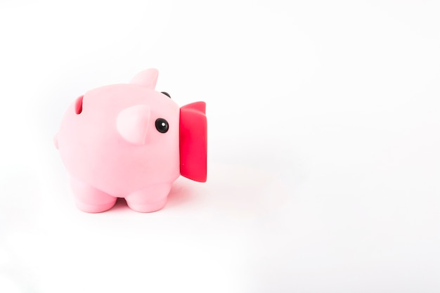 Pink piggy bank on white table