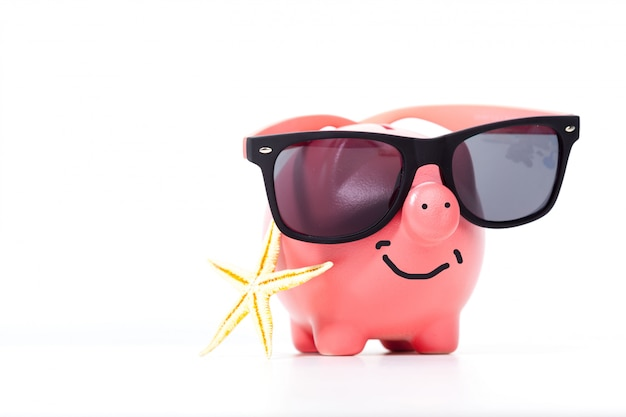 Pink piggy bank with glasses and starfish