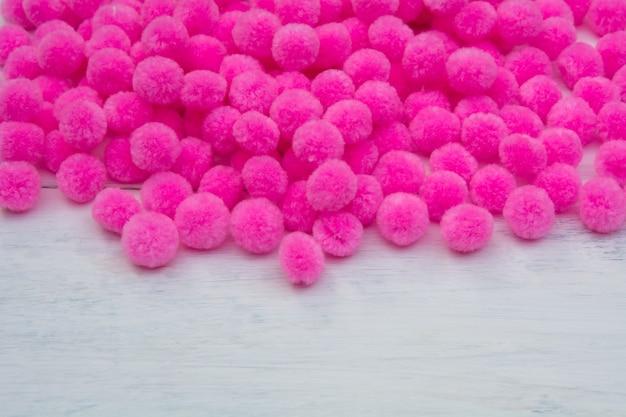Pink pom pom with white background