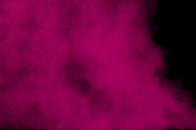Pink powder explosion on black