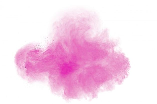 Розовый взрыв порошка на белой предпосылке. краска холи.