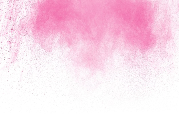 Pink powder explosion on white background. pink dust splash cloud. launched colorful parti