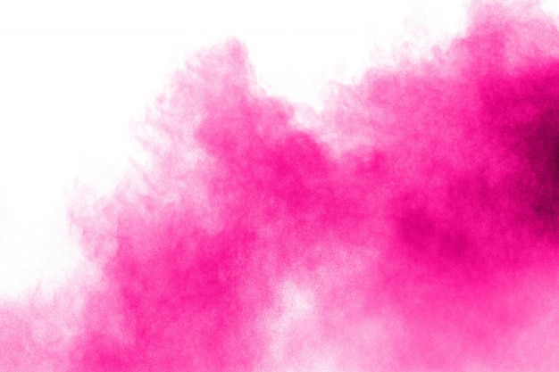 Pink powder explosion on white background.pink dust splashing.