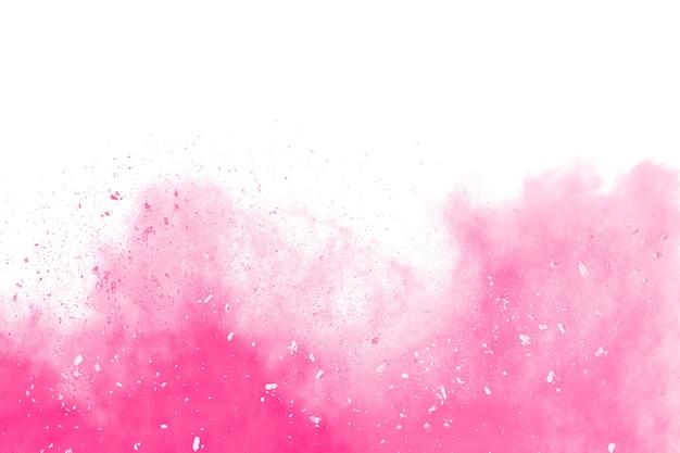 Pink powder explosion on white background