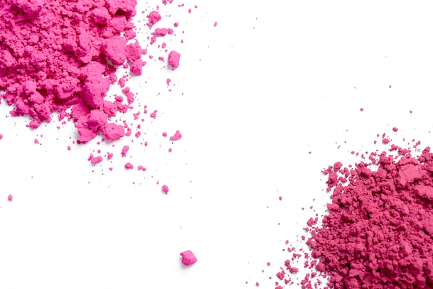 Pink powder on white background, holi festival concept