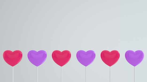 Pink and purple hearts on a stick on a white wall