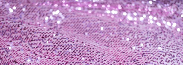 Розовая фиолетовая блестящая ткань с блестками, абстрактный фон.