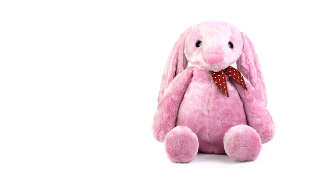 Pink rabbit doll with big ears isolated on white background