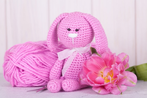 Pink rabbit with tulips. st. valentine's day decor. knitted toy, amigurumi,