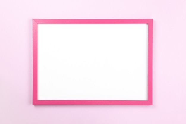 Pink rectangular frame with empty clean white center on pastel pink background