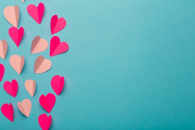Pink and red paper hearts background