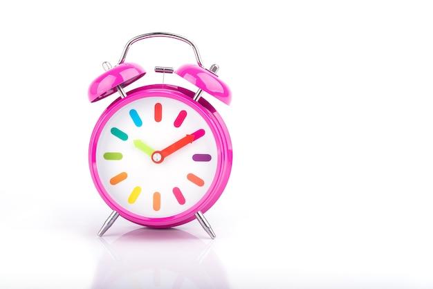 Pink retro alarm clock isolated