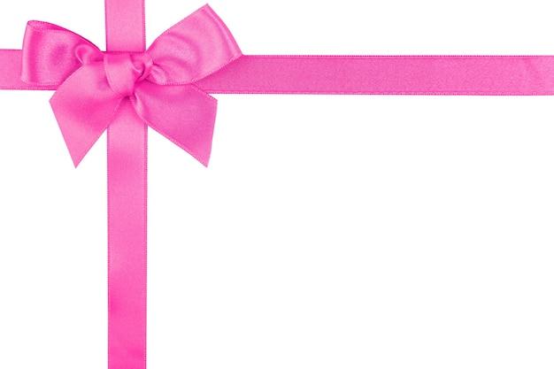 白で隔離のピンクのリボンの弓