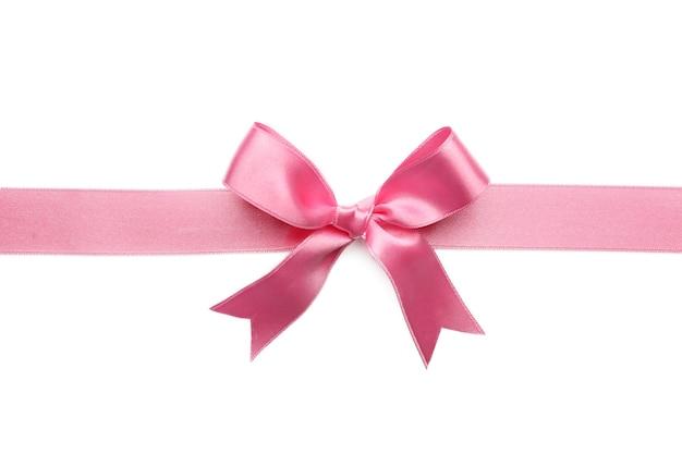 白い表面にピンクのリボンの弓