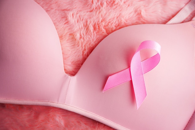 Pink ribbon breast cancer with pink bra breast cancer awareness concept