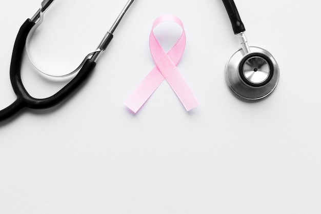 Pink ribbon below stethoscope