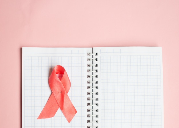 Pink ribbon symbolic bow color for breast cancer awareness month