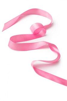 Pink ribbon on white surface