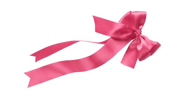 白い背景で隔離の弓とピンクのリボン
