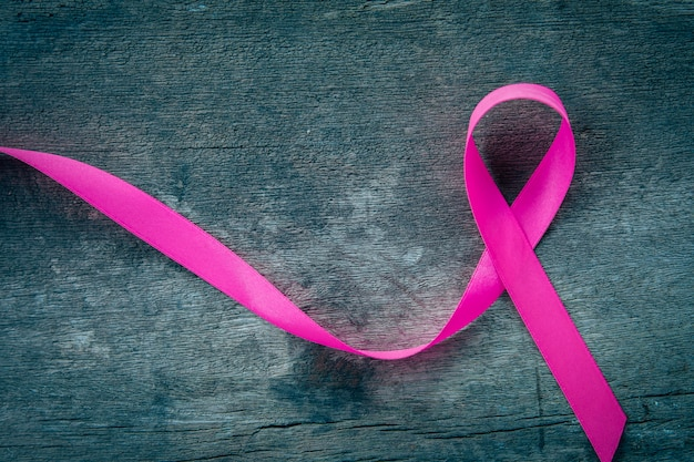 Pink ribbon on wood.  breast cancer awareness. concept healthcare and medicine