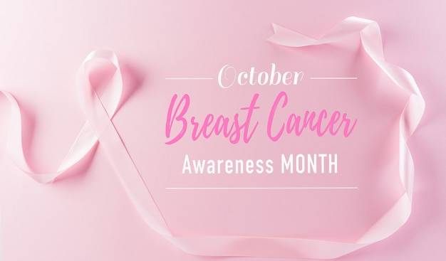 Pink ribbons on pastel background symbol of womens breast cancer awareness
