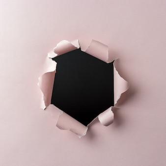 ピンクの破れた紙の背景