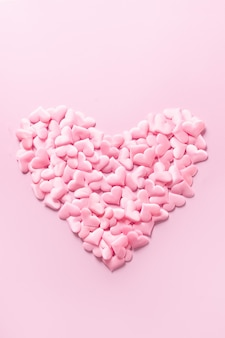 Pink romantic heart on pink background. vertical monochrome greeting valentine's day card. love concept.