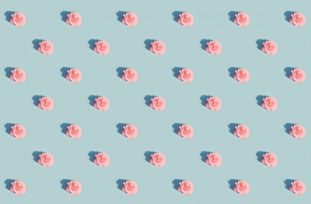 Pink rose on a blue pattern