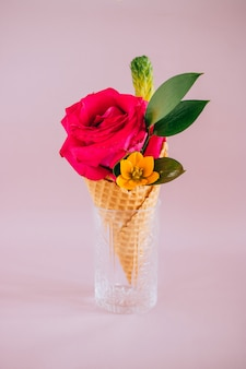 Pink rose in ice cream on pink, copy space