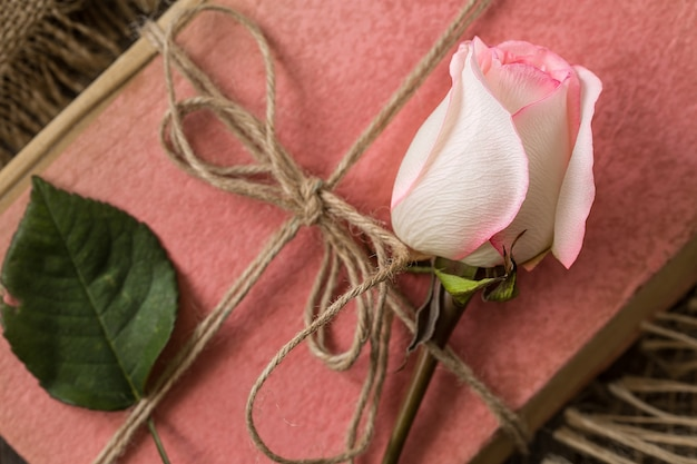 Pink rose on an old book in a vintage style