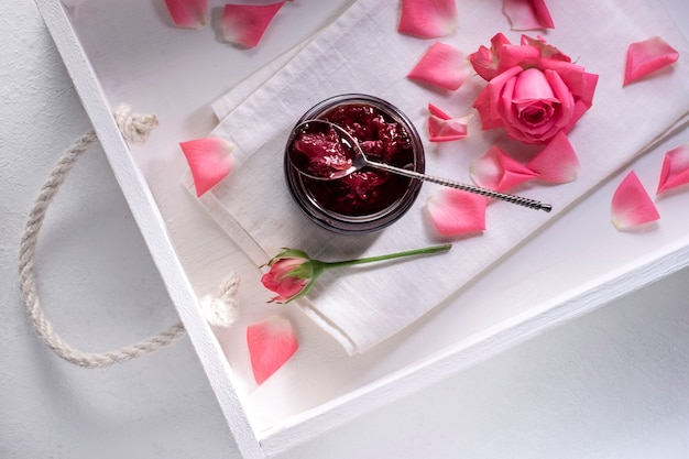 Pink rose petal jam in a white tray on the table