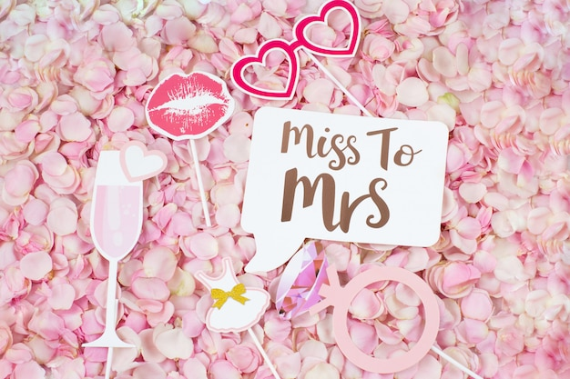 Pink rose petals and bachelorette party stickers