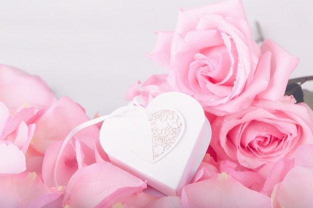 Pink roses and heart shaped box. gentle love background for valentines day