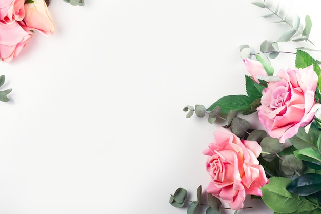 Pink roses with green leaves frame