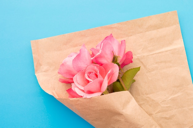 Pink roses wrapped in wrapping paper