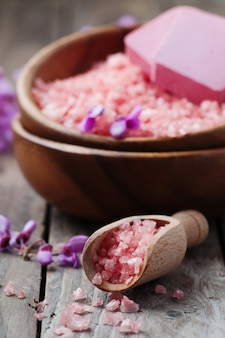 Pink salt, soap and flowers