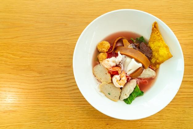 Pink seafood flat noodles