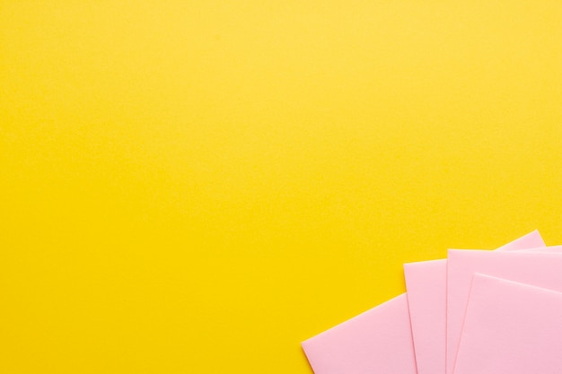 Pink set of paper sheets with copy space