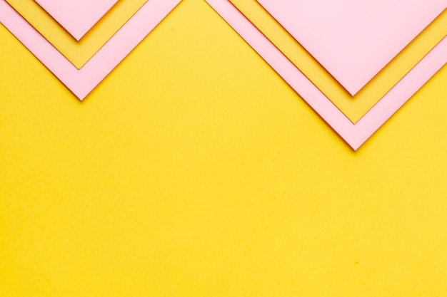 Pink set of triangular paper sheets with copy space