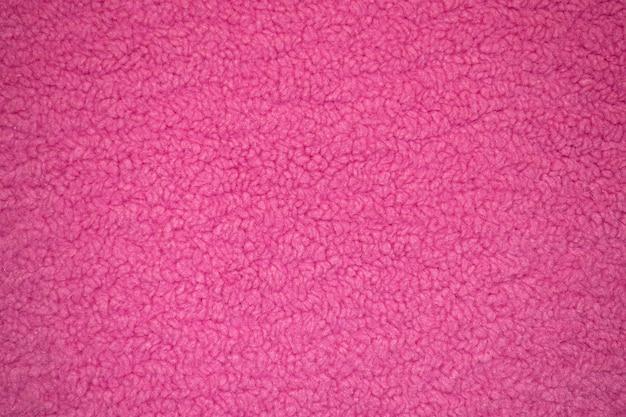 繊維の質感のあるピンクの羊の毛皮さまざまな目的のための柔らかいキャンバスのパターン