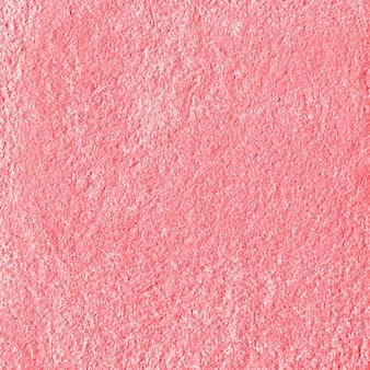 ピンクの光沢のあるテクスチャ紙の背景