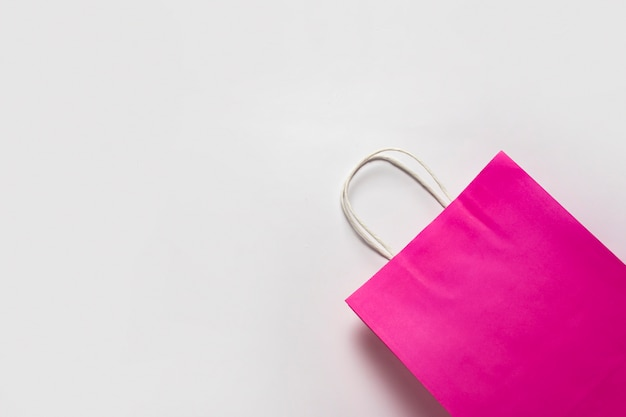 Pink shopping bag on a white background. concept shopping, discount, sale.