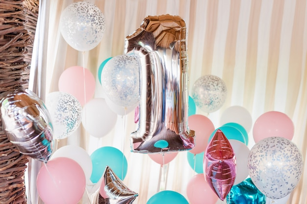 Pink, silver and blue inflatable balloons on ribbons