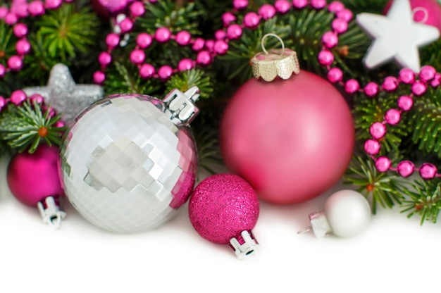 Pink and silver christmas ornaments border isolated