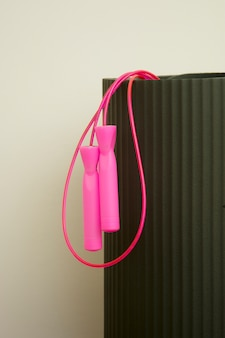 Pink skipping ropeand youga, fitness, sport mat. indoor, home workout. lose weigh.